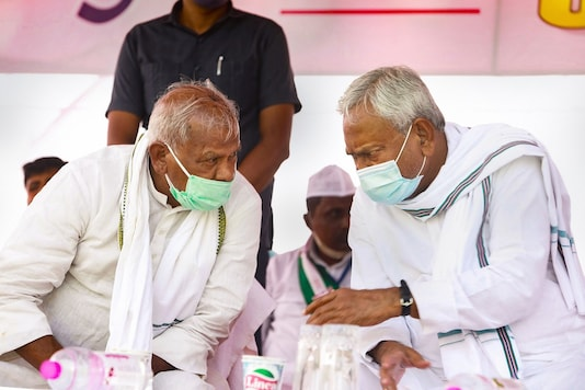 Gaya: Bihar Chief Minister Nitish Kumar (R) and HAM(S) Chief Jitan Ram Manjhi during an election meeting, at Tekari in Gaya district, Monday, Oct. 19, 2020. (PTI Photo)