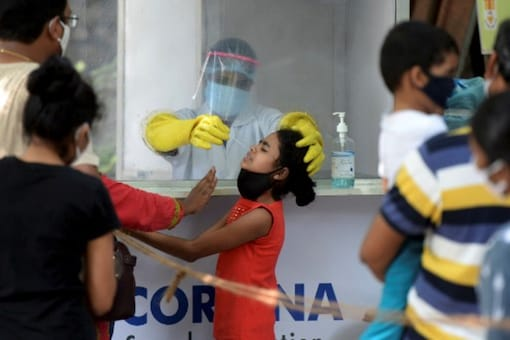 A health worker collects a swab sample from a resident to test for the Covid-19 coronavirus at a sample collection centre in Hyderabad. (Image: AFP/File)