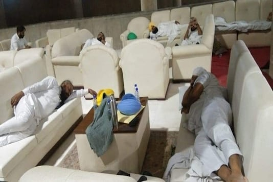 AAP MLAs sleeping inside Punjab assembly over farm laws. (Tweeted by ANI)