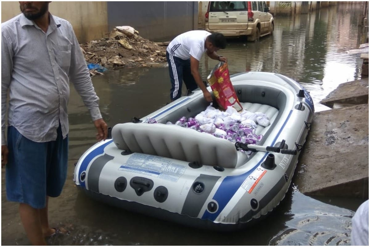 Residents of Flooded Hyderabad Colony are Using Boats to Deliver Food to Water-logged Homes