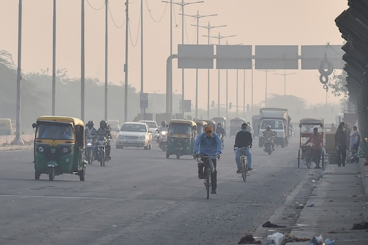 Vehicles ply amid hazy weather conditions in New Delhi. (PTI)