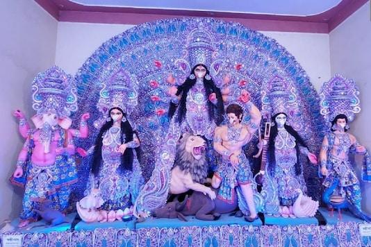 Durga idol at a puja pandal in Sainthia of Birbhum district will be seen wearing a mask. (Credit: ANI/Twitter)