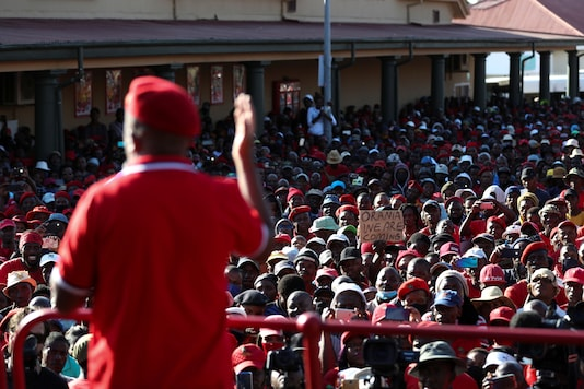Julius Malema, leader of Economic Freedom Fighters (EFF) addresses his supporters outside the Senekal magistrate's court, where two suspects for the murder of a farm manager, Brendin Horner, are to make a court appearance, in Senekal, in the Free State province, South Africa October 16, 2020. REUTERS/Siphiwe Sibeko