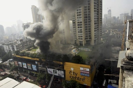 Smoke rises from Mumbai's City Central Mall where a fire broke out on Thursday evening. (PTI)