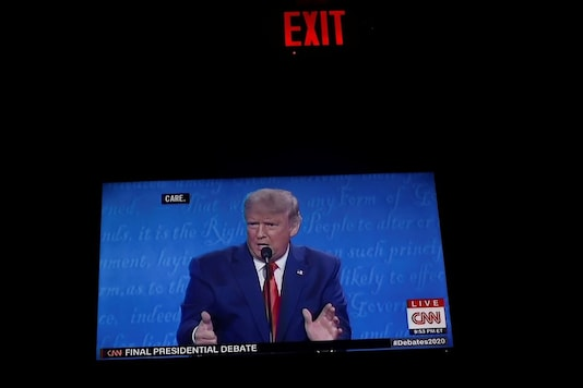 A TV screen shows U.S. President Donald Trump speaks during the final 2020 U.S. presidential campaign debate, in a bar, in Washington U.S. October 22, 2020. REUTERS/Hannah McKay