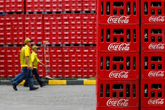 Workers walk at PT Coca-Cola Amatil Indonesia's factory in Cibitung, Indonesia's West Java province, February 24, 2011.