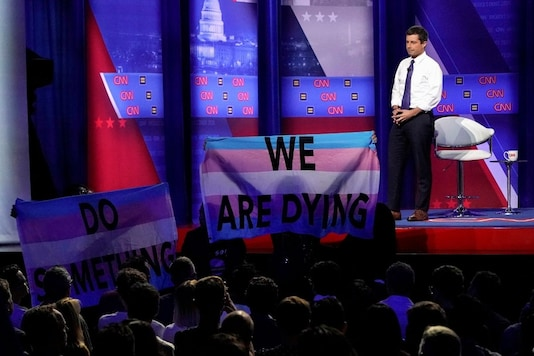 For representation: Democratic 2020 U.S. presidential candidate South Bend, Indiana Mayor Pete Buttigieg looks on as protesters hold transgender pride flags in a televised townhall on CNN dedicated to LGBTQ issues in Los Angeles, California, U.S. October 10, 2019. REUTERS/Mike Blake