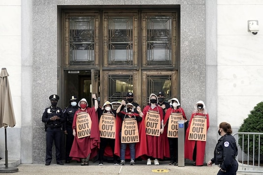 Activists dressed as characters from Margaret Atwood's
