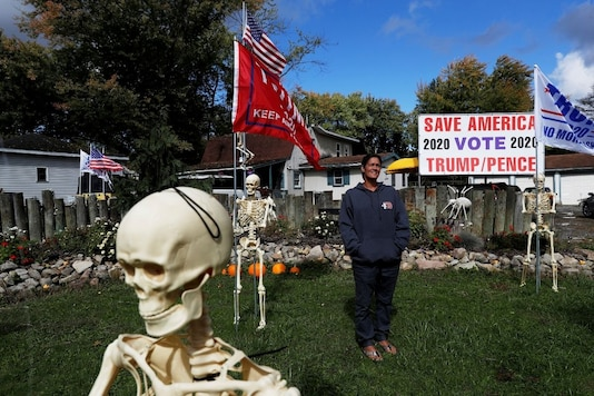For representation: Maranda Joseph, 43, poses in her front yard full of Halloween decorations and support for U.S. President Donald Trump in Warren, Ohio, U.S., October 2, 2020. REUTERS/Shannon Stapleton