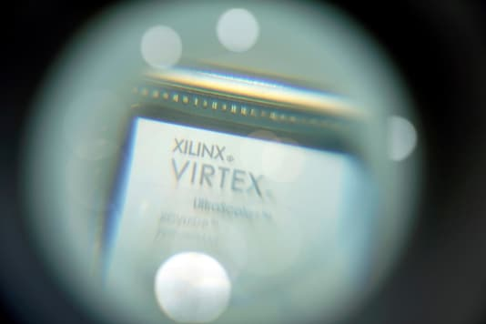 A chip of Xilinx is displayed through a magnifying glass during the China International Import Expo (CIIE), at the National Exhibition and Convention Center in Shanghai, China November 6, 2018. REUTERS/Aly Song