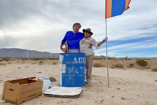 John Hunter, a supporter of U.S. President Donald Trump, and his wife Laura, who doesn't support Trump, put their political differences aside to set up water stations for people illegally crossing the US-Mexico border, in Borrego Springs, California , U.S., October 24, 2020. REUTERS/Norma Galeana