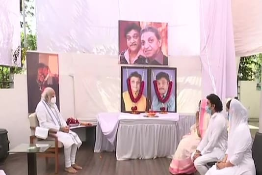 After his arrival in the morning at the Ahmedabad airport for a two-day Gujarat visit, Modi directly reached Patel's residence in Gandhinagar and offered tributes to the departed soul. The PM spent some time with Patels kin and consoled them. (Photo: ANI)