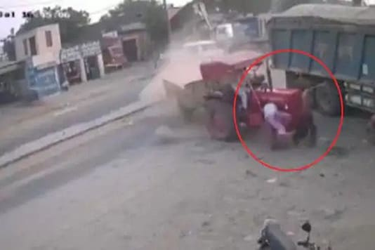 The video shows the tractor dragging the duo for a considerable distance. (Credit: news18 Lokmat/Youtube)