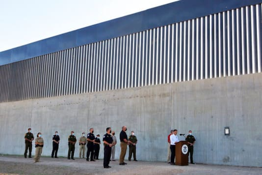 Acting Homeland Secretary Chad Wolf gives a speech in front of a new section of the border wall Thursday, Oct. 29, 2020, in McAllen, Texas. (Joel Martinez/The Monitor via AP)