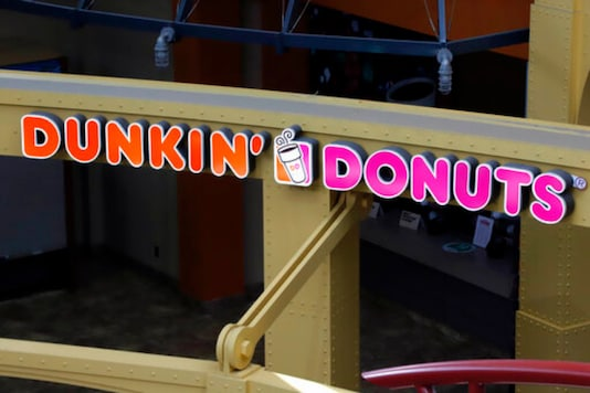 This May 7, 2020, file photo, shows a Dunkin' Donuts at the Greater Pittsburgh International Airport in Moon, Pa. The Dunkin doughnuts and coffee chain confirmed it's held talks to be taken private by a private equity firm, sending shares rocketing to an all-time high at the opening bell Monday, Oct. 26, 2020.(AP Photo/Gene J. Puskar, File)