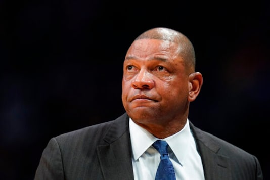 FILE - In this Jan. 12, 2020, file photo, Los Angeles Clippers coach Doc Rivers looks on during the second quarter of the team's NBA basketball game against the Denver Nuggets in Denver. The Philadelphia 76ers introduced Rivers as their head coach on Monday, Oct. 5, 2020. Rivers takes over as the 25th head coach in 76ers history after a seven-season run as head coach of the Clippers. (AP Photo/Jack Dempsey, File)