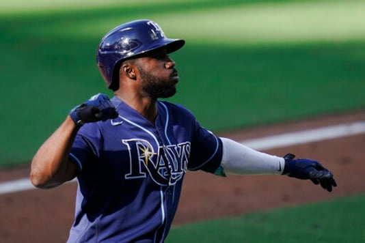 Tampa Bay Rays Randy Arozarena celebrates his solo home run against Houston Astros' Enoli Paredes during the fifth inning in Game 5 of a baseball American League Championship Series, Thursday, Oct. 15, 2020, in San Diego. (AP Photo/Gregory Bull)