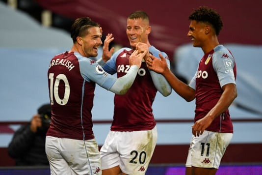 Aston Villa's Jack Grealish, celebrates after scoring his side's seventh goal with Aston Villa's Ross Barkley, center, and Aston Villa's Ollie Watkins during the English Premier League soccer match between Aston Villa and Liverpool at the Villa Park stadium in Birmingham, England, Sunday, Oct. 4, 2020. (Peter Powell/Pool via AP)