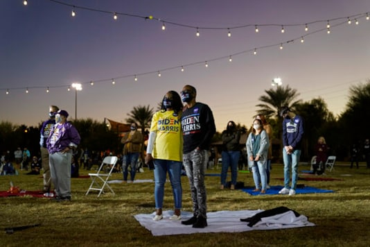People listen as Democratic vice presidential candidate Sen. Kamala Harris, D-Calif., speaks at a campaign event Tuesday, Oct. 27, 2020, in Las Vegas. (AP Photo/John Locher)