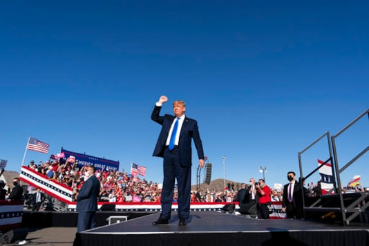 President Donald Trump arrives to speak at a campaign rally at Carson City Airport, Sunday, Oct. 18, 2020, in Carson City, Nev. (AP Photo/Alex Brandon)