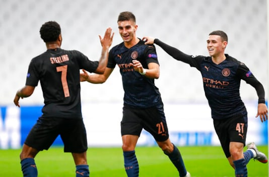 Manchester City's Ferran Torres, centre, is congratulated by teammate's Raheem Sterling, left, and Phil Foden, right, after scoring his team's first goal during the Champions League Group C soccer match between Marseille and Manchester City at Stade Velodrome in Marseille, France, Tuesday, Oct. 27, 2020. (Guillaume Horcajuelo/Pool via AP)