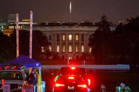 The White House is seen in Washington, early Friday, Oct. 2, 2020, after President Donald Trump announced that he and first lady Melania Trump have tested positive for the coronavirus. (AP Photo/J. Scott Applewhite)