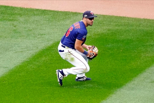 Minnesota Twins right fielder Alex Kirilloff, making his major league debut, catches a fly ball off the bat of Houston Astros' Michael Brantley in the fifth inning of an American League wild-card series baseball game, Wednesday, Sept. 30, 2020, in Minneapolis. (AP Photo/Jim Mone)