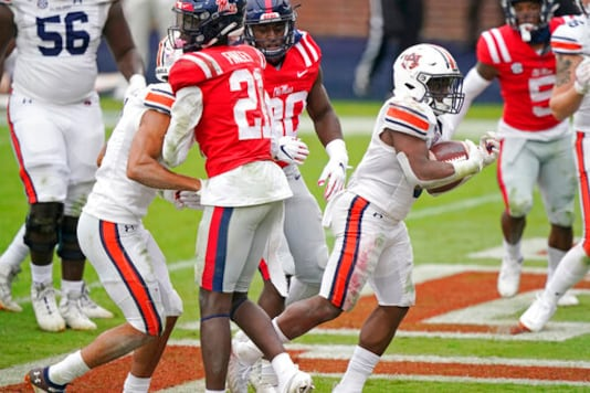 Auburn running back Shaun Shivers (8) sprints past Mississippi defenders on his way to a one-yard touchdown during the second half of an NCAA college football game in Oxford, Miss., Saturday, Oct. 24, 2020. (AP Photo/Rogelio V. Solis)