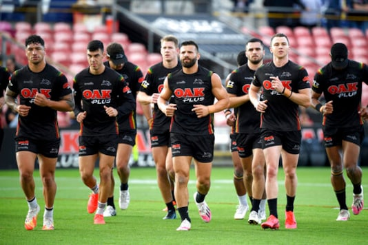 Josh Mansour of the Panthers, center, and teammates take to the field during an open training session and fan day at Panthers Stadium, Sydney, Tuesday, Oct. 20, 2020. The Penrith Panthers will take on The Melbourne Storm in the 2020 NRL Grand Final this Sunday. The final will be played in its regular Olympic stadium location in Sydney, only about 40,000 spectators will be allowed in the 85,000-seat venue because of social distancing regulations and crowd restrictions.(Dan Himbrechts/AAP Image via AP)