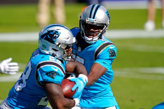 Carolina Panthers quarterback Teddy Bridgewater hands off to running back Mike Davis (28) during the second half of an NFL football game in Charlotte, N.C., Sunday, Oct. 18, 2020. (AP Photo/Brian Blanco)