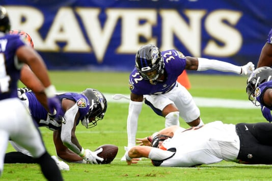 Baltimore Ravens inside linebacker Patrick Queen, bottom left, collects a fumble by Cincinnati Bengals quarterback Joe Burrow, bottom right, during the first half of an NFL football game, Sunday, Oct. 11, 2020, in Baltimore. (AP Photo/Nick Wass)