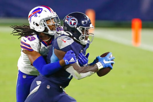 Tennessee Titans wide receiver A.J. Brown (11) is stopped by Buffalo Bills cornerback Josh Norman (29) in the second half of an NFL football game Tuesday, Oct. 13, 2020, in Nashville, Tenn. (AP Photo/Wade Payne)