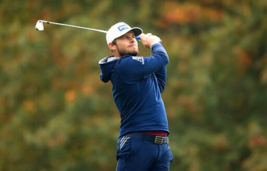 England's Tyrell Hatton on the first fairway during day four of the PGA Championship at Wentworth Club, Virginia Water, England, Sunday Oct. 11, 2020. (Adam Davy/PA via AP)