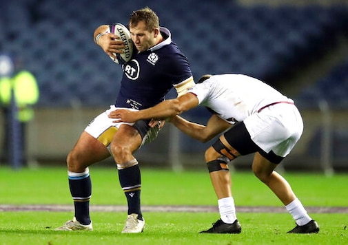 Scotland's Fraser Brown, left, is tackled by Georgia's Merab Sharikadze battle for the ball during the Autumn International rugby match at BT Murrayfield Stadium, Edinburgh, Friday Oct. 23, 2020. (Jane Barlow/PA via AP)