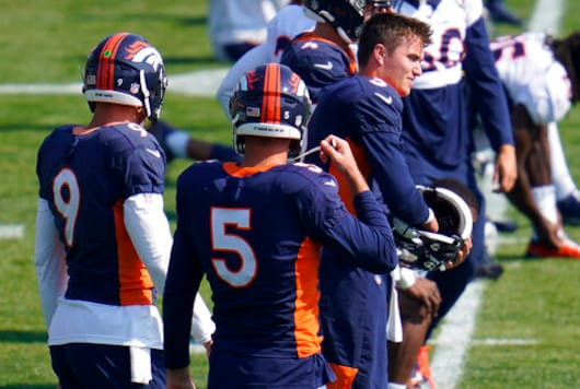 Injured Denver Broncos quarterback Drew Lock (3), right,, puts on his helmet to take part in drills during an NFL football practice at the team's training headquarters Wednesday, Oct. 7, 2020, in Englewood, Colo. (AP Photo/David Zalubowski)
