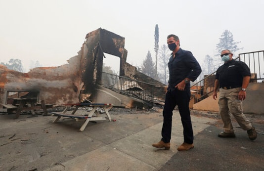 California Governor Gavin Newsom arrives at Foothills Elementary School while touring areas damaged by the Glass Fire near St. Helena, Calif., Thursday, Oct. 1, 2020.  (Christopher Chung/The Press Democrat via AP, Pool)