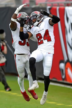 Tampa Bay Buccaneers cornerback Carlton Davis (24) celebrates his interception against the Los Angeles Chargers with free safety Jordan Whitehead (33) during the second half of an NFL football game Sunday, Oct. 4, 2020, in Tampa, Fla. (AP Photo/Jason Behnken)