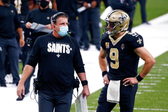 New Orleans Saints head coach Sean Payton talks with quarterback Drew Brees (9) in the first half of an NFL football game against the Los Angeles Chargers in New Orleans, Monday, Oct. 12, 2020. (AP Photo/Butch Dill)