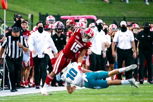 Louisiana-Lafayette running back Elijah Mitchell (15) is tackled by Coastal Carolina safety Alex Spillum (10) during the first half of an NCAA football game in Lafayette, La., Wednesday, Oct. 14, 2020. (AP Photo/Paul Kieu)