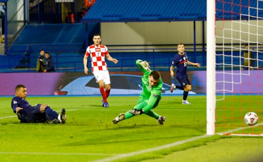 France's Kylian Mbappe, left, scores his side's second goal during the UEFA Nations League soccer match between Croatia and France at Maksimir Stadium in Zagreb, Croatia, Wednesday, Oct. 14, 2020. (AP Photo/Darko Bandic)