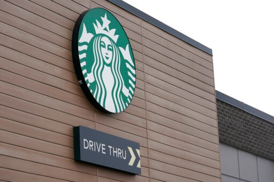 A sign at a Starbucks Coffee store in south Seattle is shown, Tuesday, Oct. 27, 2020. Starbucks saw faster-than-expected recovery in the U.S. and China in its fiscal fourth quarter, giving it confidence as it heads into the holiday season. (AP Photo/Ted S. Warren)