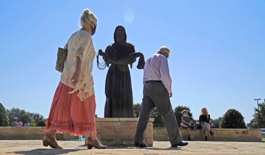 A bronze statue of Jesus Christ sits on display outside of the Prestonwood Baptist Church Sunday, Oct. 11, 2020, in Plano, Texas. Evangelical churches and their suburban members are a key to President Donald Trump's voter support in Texas. (AP Photo/LM Otero)