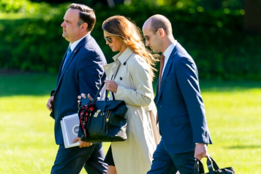 From left, White House Social Media Director Dan Scavino, Counselor to the President Hope Hicks, and President Donald Trump's White House senior adviser Stephen Miller, walk across the South Lawn to board Marine One on the South Lawn of the White House in Washington, Monday, Sept. 21, 2020, for a short trip to Andrews Air Force Base, Md., and then on to Ohio for rallies with President Donald Trump. (AP Photo/Andrew Harnik)