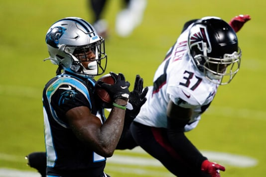 Carolina Panthers wide receiver Curtis Samuel scores past Atlanta Falcons free safety Ricardo Allen during the first half of an NFL football game Thursday, Oct. 29, 2020, in Charlotte, N.C. (AP Photo/Gerry Broome)