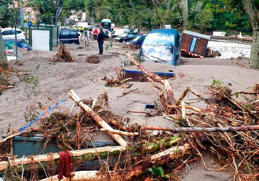 This photo released by the French Securite Civile Monday Oct.5, 2020 shows a man standing in the middle of a flooded street in Breil-sur-Roya, near the border with Italy, Saturday Oct. 3, 2020. Flooding has devastated mountainous areas in France's southeastern region of Alpes-Maritimes and Italy's northwestern regions of Liguria and Piedmont, after a storm swept through the two countries on Friday and Saturday. (Scurit Civile-UIISC via AP)