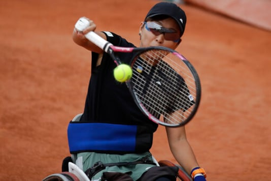 Japan's Momoko Ohtani plays a shot against Japan's Yui Kamiji in the women's wheelchair final match of the French Open tennis tournament at the Roland Garros stadium in Paris, France, Friday, Oct. 9, 2020. (AP Photo/Alessandra Tarantino)