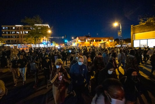 Demonstrators block an intersection in Minneapolis on Wednesday, Oct. 7, 2020, after Derek Chauvin, the former Minneapolis police officer charged with murder in the death of George Floyd, posted bail and was released from prison. (Carlos Gonzalez/Star Tribune via AP)