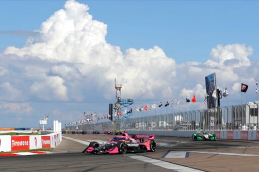 Alexander Rossi (27) leads into Turn 1 during an IndyCar auto race Sunday, Oct. 25, 2020, in St. Petersburg, Fla. (AP Photo/Mike Carlson)