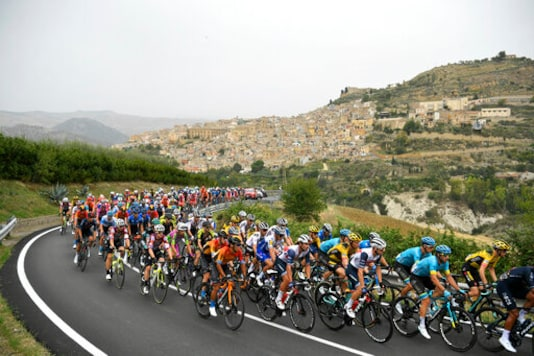 Cyclists pedal along a road during the third stage of the Giro d'Italia, tour of Italy cycling race from Enna to Etna, Sicily, Monday, Oct. 5, 2020. (Fabio Ferrari/LaPresse via AP)