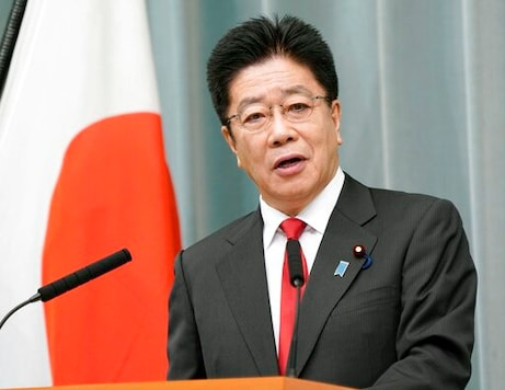 Chief Cabinet Secretary Katsunobu Kato speaks during a press conference at the prime ministers office in Tokyo Monday, Oct. 26, 2020. Japan said it will not sign a U.N. treaty to ban nuclear weapons and did not even welcome its entry into force next year, rejecting wishes of atomic bombing survivors for their own government to join their move to achieve a nuclear free world.(Kyodo News via AP)